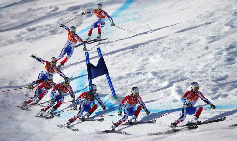 France's Alexis Pinturault clears a gate during the second run of the men's alpine skiing giant slalom event at the 2014 Sochi Winter Olympics at the Rosa Khutor Alpine Center February 19, 2014. REUTERS/Dominic Ebenbichler