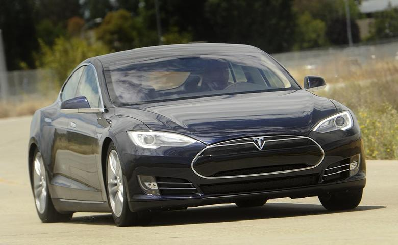 A Tesla Model S electric sedan is driven near the company's factory in Fremont, California, June 22, 2012. Tesla began delivering the electric sedan to customers on June 22. REUTERS/Noah Berger