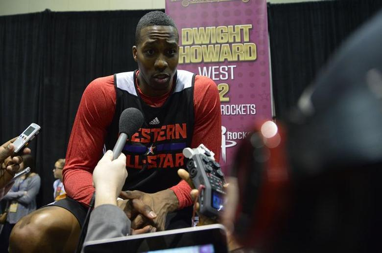 Feb 15, 2014; New Orleans, LA, USA; 2014 Western Conference All-Stars center Dwight Howard (Rockets) (12) talks to the media after the practice session at Ernest N. Morial Convention Center. Mandatory Credit: Bob Donnan-USA TODAY Sports - RTX18WKL