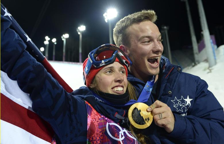 Winner Maddie Bowman of the U.S. and her compatriot gold medallist in the men's freestyle halfpipe skiing David Wise pose after the women's freestyle skiing halfpipe final at the 2014 Sochi Winter Olympic Games in Rosa Khutor February 20, 2014. REUTERS/Dylan Martinez