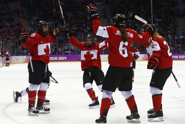 Canada's Brianne Jenner (L) celebrates her goal against Team USA with teammates Catherine Ward, Rebecca Johnston (6) and Haley Irwin (R) during the third period of their women's ice hockey gold medal game at the Sochi 2014 Winter Olympic Games February 20, 2014. REUTERS/Mark Blinch