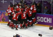 Canada's players celebrate after defeating Team USA to win their women's ice hockey gold medal game at the Sochi 2014 Winter Olympic Games February 20, 2014. REUTERS/Jim Young