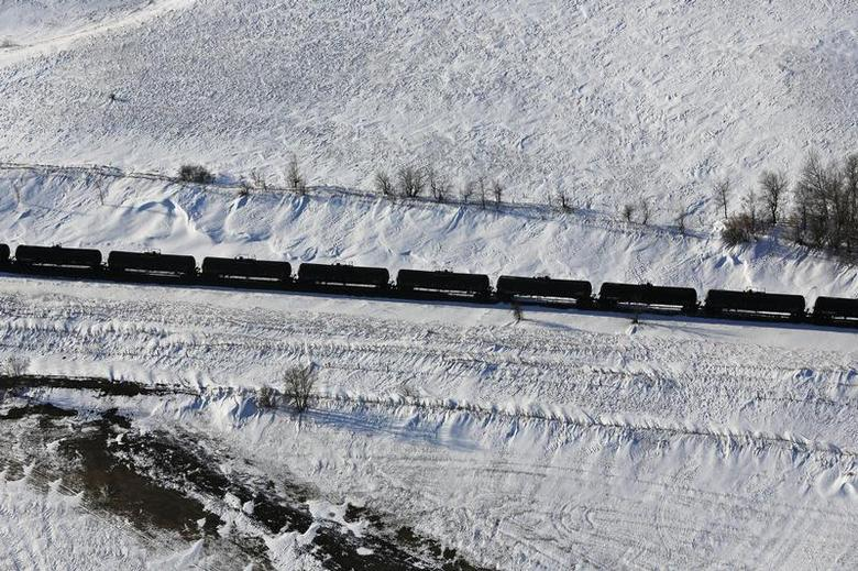 A train makes its way along the Burlington Northern Santa Fe (BNSF) rail line outside of Williston, North Dakota March 12, 2013. REUTERS/Shannon Stapleton