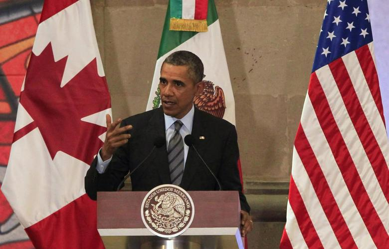 U.S. President Barack Obama gives a speech during a news conference next to Canada's Prime Minister Stephen Harper and Mexico's President Enrique Pena Nieto (both not pictured) at the North American Leaders' Summit in Toluca near Mexico City, February 19, 2014. REUTERS/Henry Romero