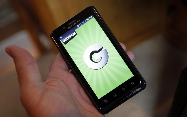The Groupon smartphone app is displayed on a Motorola Droid Bionic cell phone in Denver November 4, 2011. REUTERS/Rick Wilking