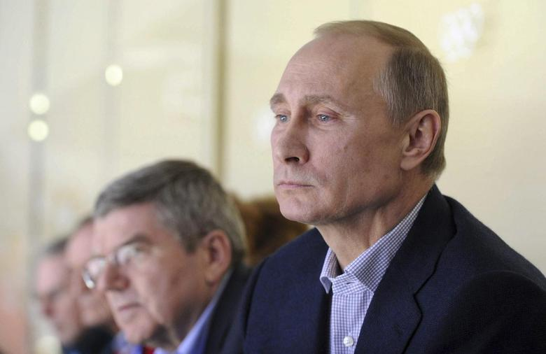 Russia's President Vladimir Putin (R) watches the men's preliminary round ice hockey game between Russia and the U.S. at the Sochi 2014 Winter Olympic Games February 15, 2014 file photo. REUTERS/Mikhail Klimentyev/RIA Novosti/Kremlin