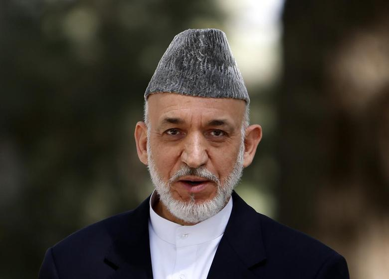 Afghan President Hamid Karzai speaks during a news conference in Kabul October 7, 2013 file photo. REUTERS/Mohammad Ismail