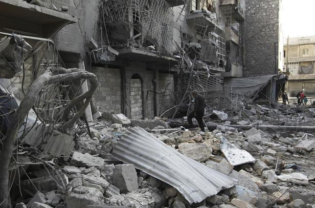 A man walks amid rubble of damaged buildings in the al-Myassar neighbourhood of Aleppo February 19, 2014. REUTERS/Jalal Al-Mamo