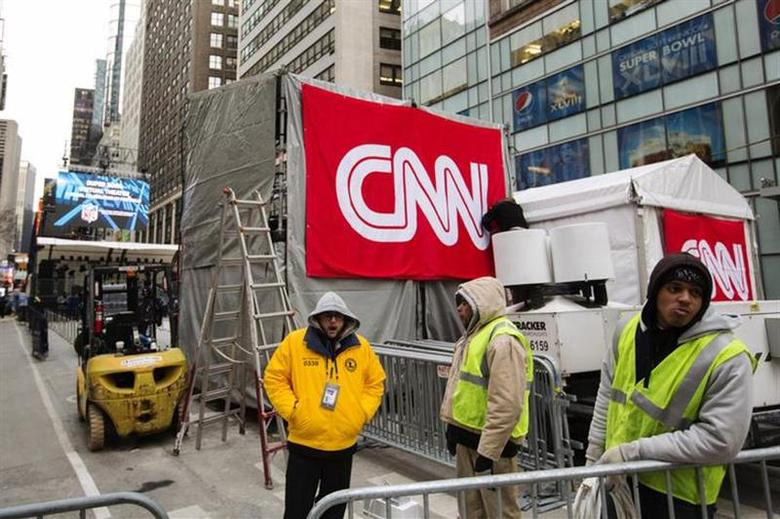 Workers wait to finish setting up a CNN booth in New York January 28, 2014. REUTERS/Lucas Jackson