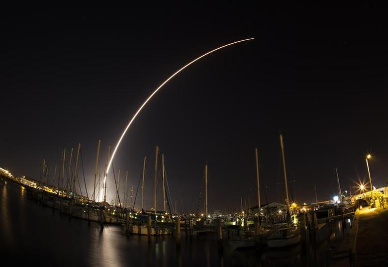 A view of the Delta IV rocket streaking across the sky after launching from Cape Canaveral Air Force Station is seen from Port Canaveral, Florida February 20, 2014. REUTERS/Mike Brown
