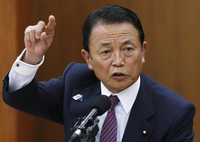 Japan's Finance Minister Taro Aso speaks during a semi-annual parliament hearing on monetary policy at the Lower House of the parliament in Tokyo June 19, 2013. REUTERS/Issei Kato