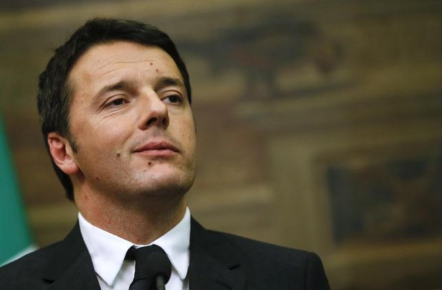 Italian Prime Minister-designate Matteo Renzi listens to reporters' questions at the end of consultations with leaders of Italian parties at the Parliament in Rome February 19, 2014. REUTERS/Tony Gentile