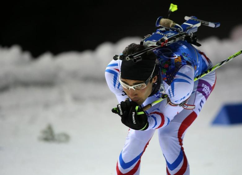 France's Martin Fourcade skis during the mixed biathlon relay at the Sochi 2014 Winter Olympics February 19, 2014. REUTERS/Sergei Karpukhin