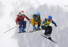 From L-R: Canada's Georgia Simmerling, Germany's Anna Woerner and Australia's Sami Kennedy-Sim compete during the women's freestyle skiing skicross eighth-finals at the 2014 Sochi Winter Olympic Games in Rosa Khutor February 21, 2014. REUTERS/Mike Blake