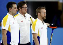 Sweden's second Fredrik Lindberg, lead Viktor Kjaell and skip Niklas Edin (L-R) stand during their men's bronze medal curling game against China at the Ice Cube Curling Center during the Sochi 2014 Winter Olympics, February 21, 2014. REUTERS/Marko Djurica