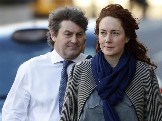 Former News International chief executive Rebekah Brooks and her husband Charlie Brooks arrive at the Old Bailey courthouse in London February 21, 2014. REUTERS/Luke MacGregor