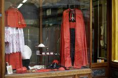 Cardinals vestments are seen on display at the window of the Gammarelli tailor shop in Rome February 11, 2014. REUTERS/Max Rossi