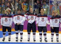 Team USA's Monique Lamoureux, Megan Bozek, Meghan Duggan, Julie Chu and Brianna Decker (L-R) stand dejected after losing their women's gold medal ice hockey game against Canada at the Sochi 2014 Winter Olympic Games February 20, 2014. REUTERS/Gary Hershorn
