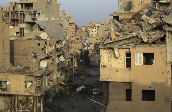 A view shows damaged buildings in Deir al-Zor, eastern Syria February 19, 2014. REUTERS/Khalil Ashawi