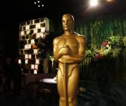 A large Oscar statue is seen in the Dolby Ballroom during the 86th Oscars Governors Ball press preview in Hollywood, California February 20, 2014. REUTERS/Fred Prouser