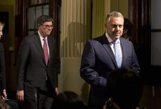 U.S. Treasury Secretary Jack Lew and Australian Treasurer Joe Hockey (R) walk from a joint news conference at the G20 Finance Ministers meeting in Sydney, February 21, 2014. REUTERS/Jason Reed