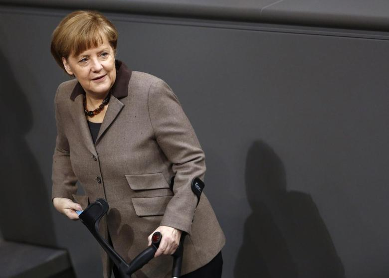 German Chancellor Angela Merkel arrives to cast her votes after a debate about deputy allowances and graft at the lower house of parliament, the Bundestag, in Berlin February 21, 2014. REUTERS/Thomas Peter