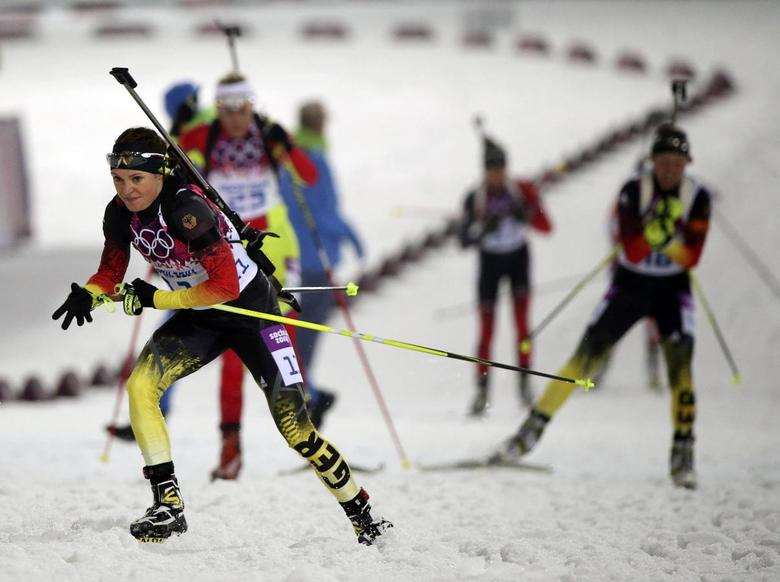 Germany's Evi Sachenbacher-Stehle (front) competes during the women's biathlon 10km pursuit event at the 2014 Sochi Winter Olympics, in this file picture taken February 11, 2014. REUTERS/Sergei Karpukhin/Files
