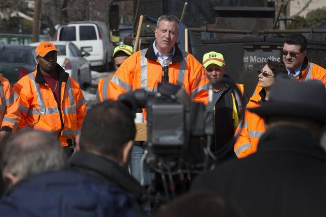 New York Mayor Bill de Blasio speaks to the press during a news conference in the Maspeth section of Queens, New York February 20, 2014. REUTERS/Brendan McDermid