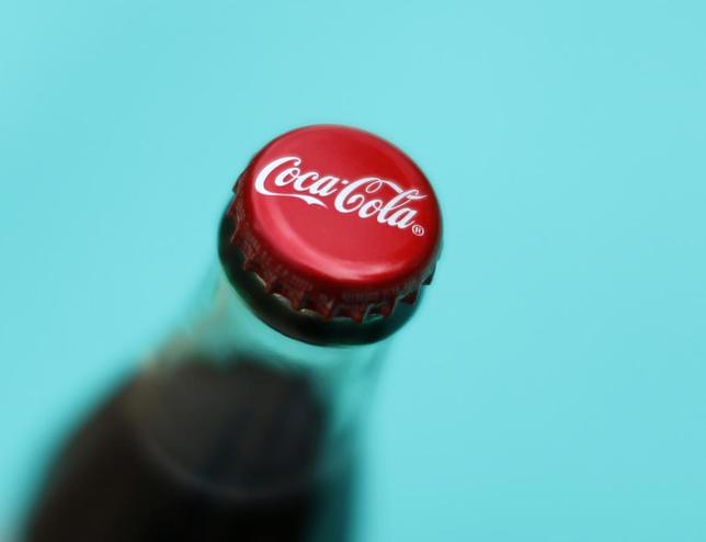 A bottle of Coca-Cola is shown in this photo illustration in Encinitas, California October 10, 2013. REUTERS/Mike Blake