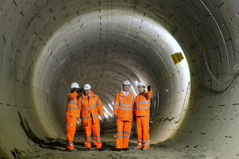 Britain's Prime Minister David Cameron (2nd R) and London Mayor Boris Johnson (2nd L) visit a Crossrail construction site beneath Tottenham Court Road in central London January 16, 2014. REUTERS/Ben Stansall/pool