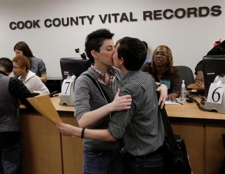 Robin Petrovic (R) kisses Jamie Gayle after they received their Civil Union license in Chicago, June 1, 2011 file photo. REUTERS/John Gress