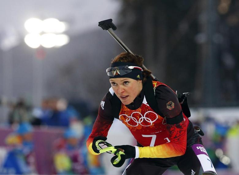 Germany's Evi Sachenbacher-Stehle leaves the shooting range during the mixed biathlon relay at the Sochi 2014 Winter Olympics, in this picture taken February 19, 2014. REUTERS/Michael Dalder/Files