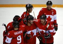 Canada's Jamie Benn (22) celebrates with teammates Patrick Marleau (C), Sidney Crosby (R), Jonathan Toews (16) and Matt Duchene after their win over Team USA at the conclusion of the men's ice hockey semi-final game at the 2014 Sochi Winter Olympic Games, February 21, 2014. REUTERS/Brian Snyder