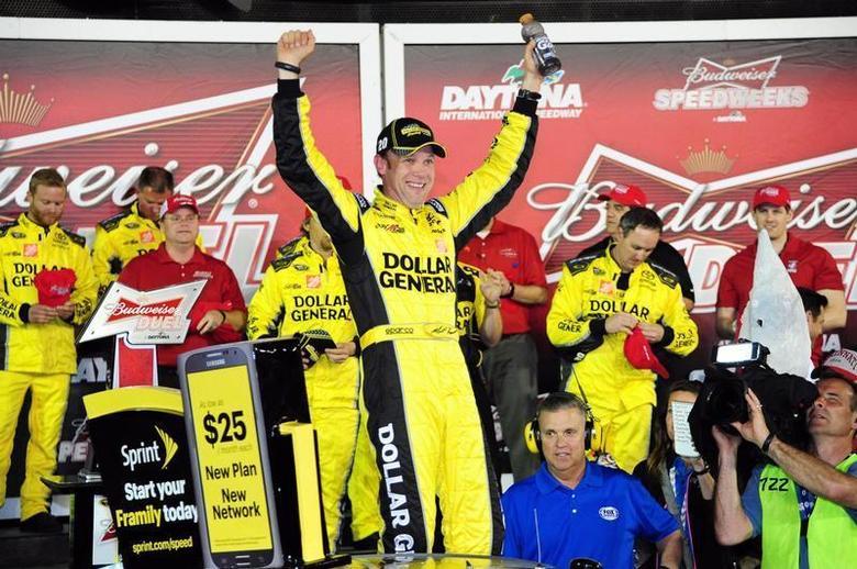Feb 20, 2014; Daytona Beach, FL, USA; NASCAR Sprint Cup driver Matt Kenseth (20) celebrates winning race one of the Budweiser Duel at Daytona International Speedway. Mandatory Credit: Jasen Vinlove-USA TODAY Sports - RTX197XE