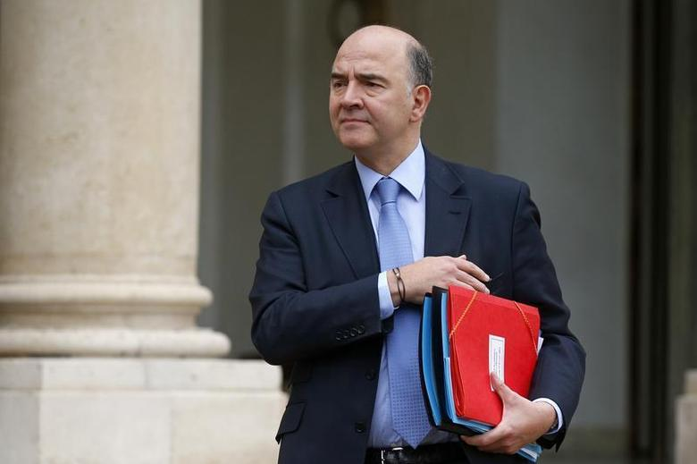 French Finance Minister Pierre Moscovici leaves after the weekly cabinet meeting at the Elysee Palace in Paris February 19, 2014. REUTERS/Benoit Tessier