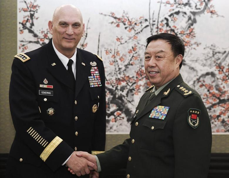 U.S. Army Chief of Staff General Ray Odierno (L) shakes hands with Fan Changlong, vice chairman of China's Central Military Commission, at Bayi Building in Beijing February 21, 2014. REUTERS/Lintao Zhang/Pool