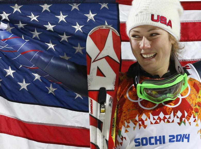 First-placed Mikaela Shiffrin of the U.S. poses with a U.S. flag during the flower ceremony for the women's alpine skiing slalom event at the 2014 Sochi Winter Olympics at the Rosa Khutor Alpine Centre, February 21, 2014. REUTERS/Leonhard Foeger