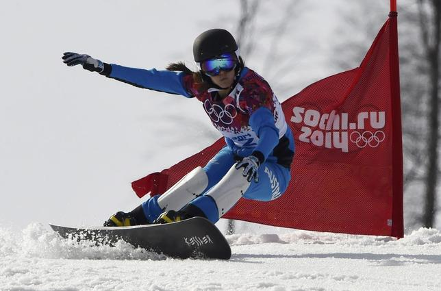 Austria's Julia Dujmovits competes during the women's parallel slalom snowboard finals at the 2014 Sochi Winter Olympic Games in Rosa Khutor February 22, 2014. REUTERS/Dylan Martinez