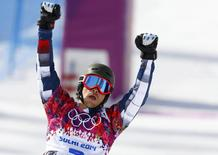 Russia's Vic Wild reacts after crossing the finish line during the men's parallel slalom snowboard finals at the 2014 Sochi Winter Olympic Games in Rosa Khutor February 22, 2014. REUTERS/Lucas Jackson