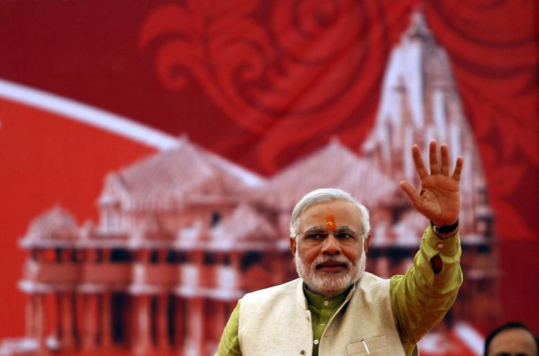 Hindu nationalist Narendra Modi, prime ministerial candidate for India's main opposition Bharatiya Janata Party (BJP) and Gujarat's chief minister, waves to his supporters during a public meeting at Somnath in the western Indian state of Gujarat February 1, 2014. REUTERS/Amit Dave