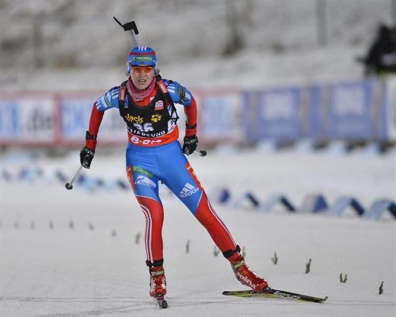 Ekaterina Glazyrina of Russia crosses the finish line during the women's 15 km individual event at the Biathlon World Cup in Ostersund November 29, 2012. REUTERS/Anders Wiklund/Scanpix Sweden