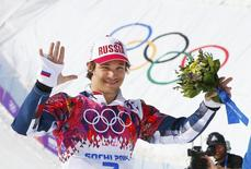 Russia's winner Vic Wild celebrates during flower ceremony after the men's parallel snowboard finals at the 2014 Sochi Winter Olympic Games in Rosa Khutor February 22, 2014. REUTERS/Lucas Jackson