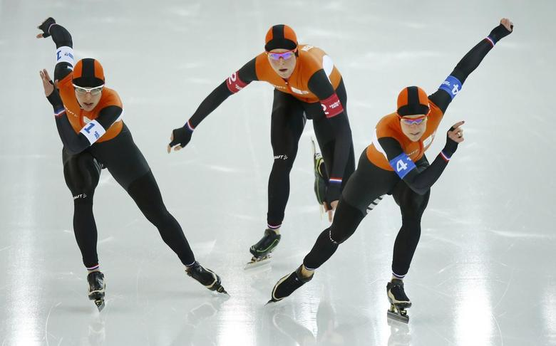 (L-R) Marrit Leenstra, Jorien Ter Mors and Irene Wust of the Netherlands compete in the women's speed skating team pursuit semi-finals during the 2014 Sochi Winter Olympics, February 22, 2014. REUTERS/Marko Djurica