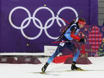 Russia's Anton Shipulin skis during the men's biathlon 4 x 7.5 km relay at the Sochi 2014 Winter Olympic Games February 22, 2014. REUTERS/Stefan Wermuth