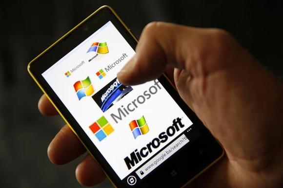 A Nokia Lumia 820 smartphone with Microsoft logos on the screen is shown in a photo illustration taken in the central Bosnian town of Zenica, September 3, 2013.REUTERS/Dado Ruvic/Files