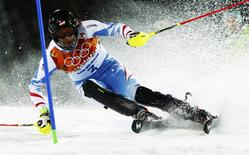 Austria's Mario Matt skis to finish first during the second run of the men's alpine skiing slalom event at the 2014 Sochi Winter Olympics at the Rosa Khutor Alpine Center February 22, 2014. REUTERS/Ruben Sprich