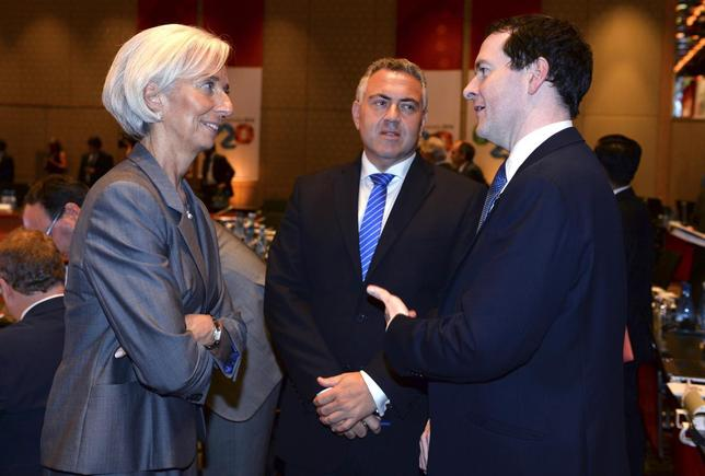 International Monetary Fund Managing Director Christine Lagarde (L) chats with Britain's Chancellor of the Exchequer George Osbourne (R) and Australia's Treasurer Joe Hockey before the G20 Finance Ministers and Central Bank Governors round table meeting in Sydney, February 22, 2014. REUTERS/William West/Pool