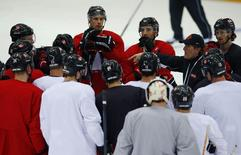 Canada's men's ice hockey team head coach Mike Babcock speaks to his team during a practice at the 2014 Sochi Winter Olympics, February 22, 2014. REUTERS/Jim Young