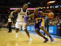 Dec 17, 2013; Memphis, TN, USA; Memphis Grizzlies shooting guard Tony Allen (9) guards Los Angeles Lakers shooting guard Kobe Bryant (24) during the fourth quarter at FedExForum. Justin Ford-USA TODAY Sports