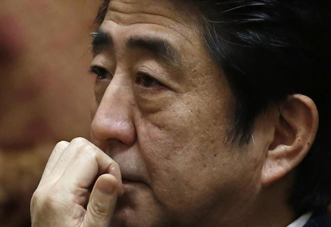 Japan's Prime Minister Shinzo Abe attends a lower house budget committee session at the parliament in Tokyo February 20, 2014. REUTERS/Yuya Shino